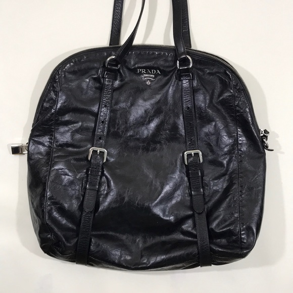 ee56e5ff6e97 Prada Leather Buckles Tote Black. M_5b0cff7fdaa8f67cb8b833bd